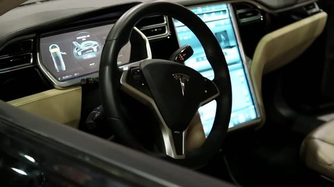 UKRAINE, KIEV, JUNE 10, 2016: Exhibition of electric cars. Inside Tesla electromobile. Tesla electromobile interior