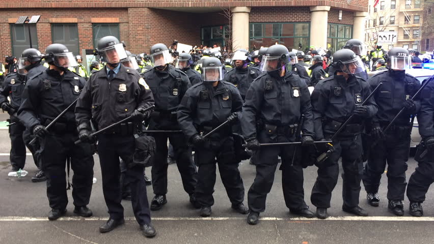 WASHINGTON, Jan. 20, 2017 -- Police in riot gear with batons and helmets form a line surrounding detained #DisruptJ20 protesters during the presidential inauguration of Donald Trump.