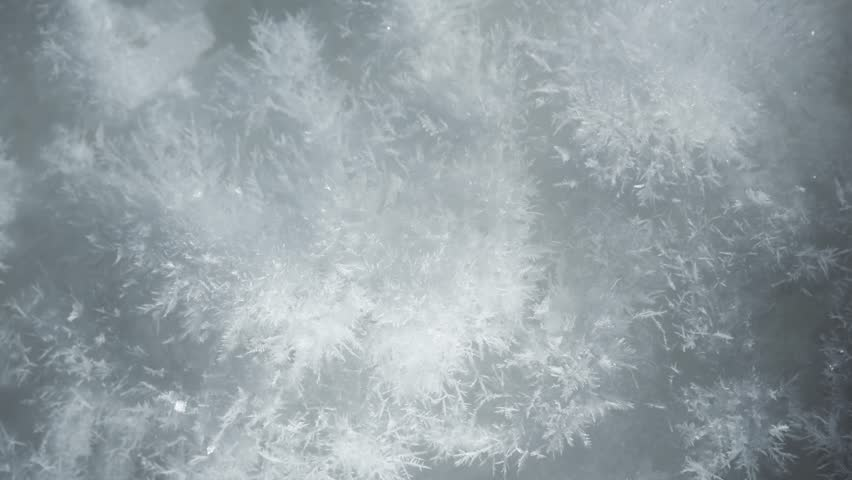 Three different macro shots of growing snow crystals, compilation of ice crystal