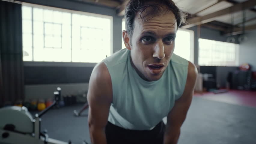 Man breathing deeply after intense gym session function fitness routine #23392906