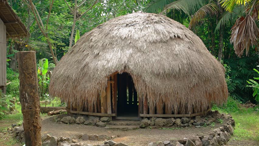 Indonesian House With Thatched Roof. On Display For Educational Purposes