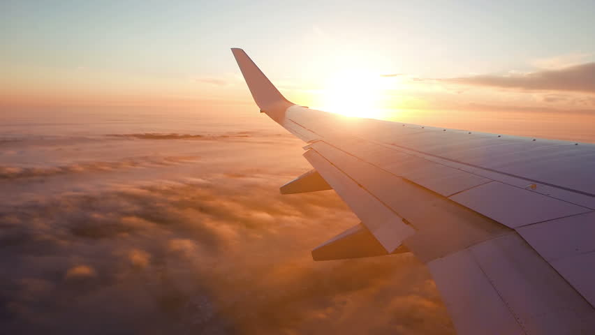 Aerial view of sunrise through airliner window | Shutterstock HD Video #23524966
