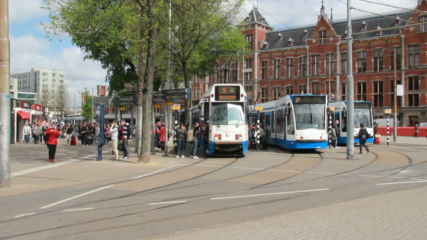 AMSTERDAM, HOLLAND - MAY 25: Tram departs from the Central Railway Station on May 25, 2012 in Amsterdam, Holland. Trams are the most popular means of public transportation in Amsterdam