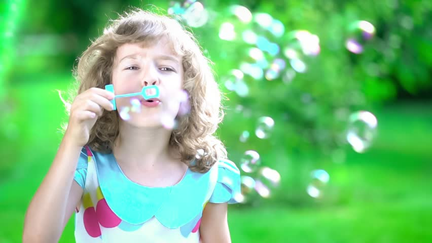 Little Girl Smiling While Using Squirt Gun Stock Footage Video 4435778  Shutterstock-9584