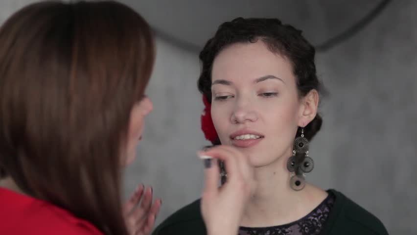 Make-up artist working with model   Shutterstock HD Video #23558356