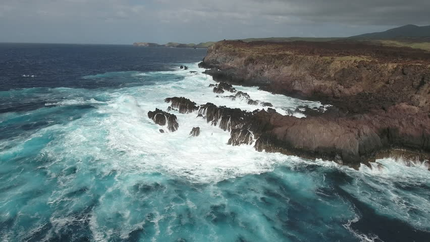 Aerial shot of ocean waves crashing coastline cliff, steep - Socorro Island | Shutterstock HD Video #23572606