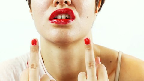 Angry young woman making obscene hand gesture by showing middle finger.