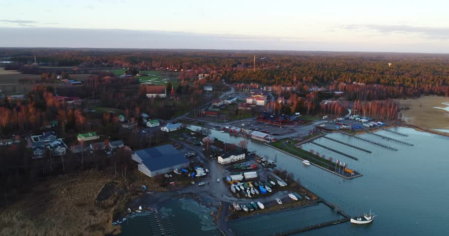 Cinema 4k aerial orbit flight of Inkoo town, at a late evening sunset, in the finnish archipelago, in Finland.: | Shutterstock HD Video #23581939