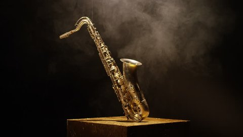 Close-up shot of a beautiful saxophone on black background. Shot on RED HELIUM Cinema Camera in slow motion. 4K