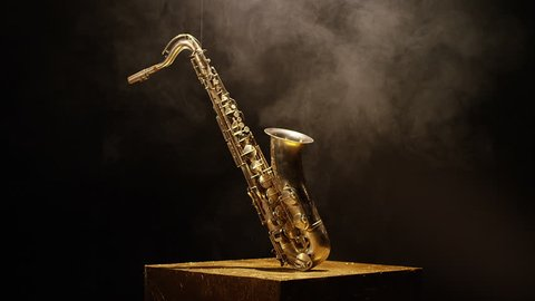 Close-up shot of a beautiful saxophone on black background. Shot on RED HELIUM Cinema Camera in slow motion.