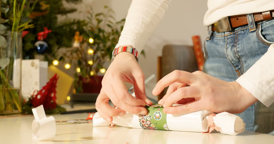 Young woman cooking meat stock footage video 712258 shutterstock side view close up of designer woman wrapping gift wrapped gift using scissor for the negle Images