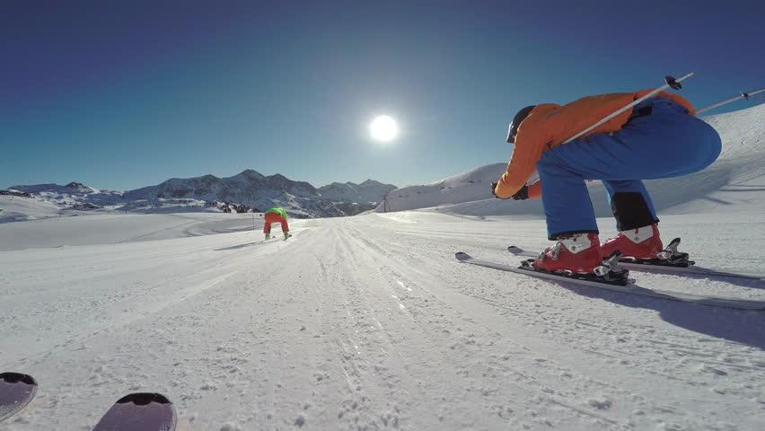 4k skiing footage, skier point of view two skiers overtaking on flat ski slope in skiing region  | Shutterstock HD Video #23637544