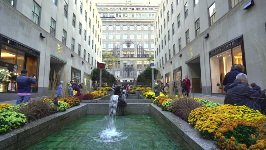 Rockefeller Center fountains, slider shot - October 2016. New York City street scene, United States