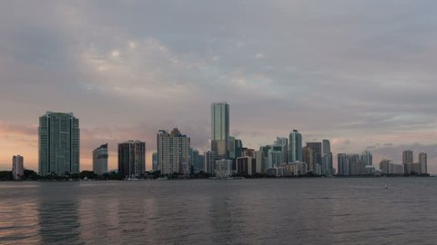 4K Timelapse Miami city skyline panorama at dusk with urban skyscrapers medium close up