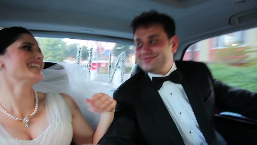 bride and groom dance in the car