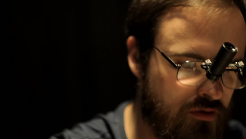 Man with a beard in the magnifying glasses close-up | Shutterstock HD Video #23716186