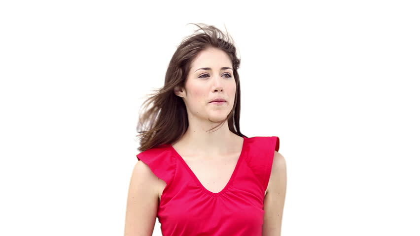 Woman looking away while the wind blows through her hair against a white background | Shutterstock HD Video #2371736