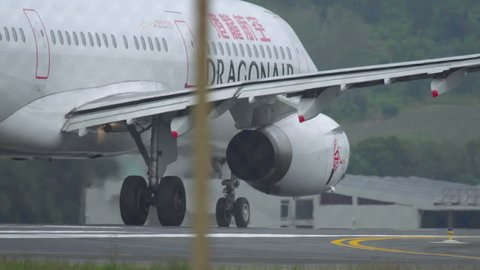 PHUKET, THAILAND - DECEMBER 1, 2016: Airbus 321 Cathay Dragon B-HTD accelerate before departure from Phuket airport