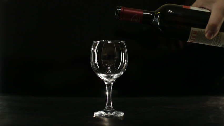 Hd00:12glass Of Red Wine On A Black Background Backlit