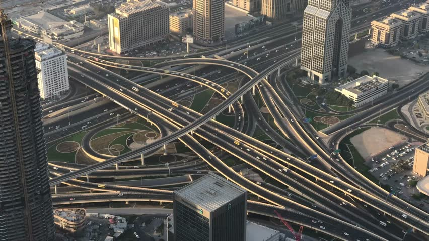 DUBAI, UAE - DECEMBER 2016: Time lapse of traffic intersections, aerial view. Dubai suffers heavy car traffic. | Shutterstock HD Video #23743045