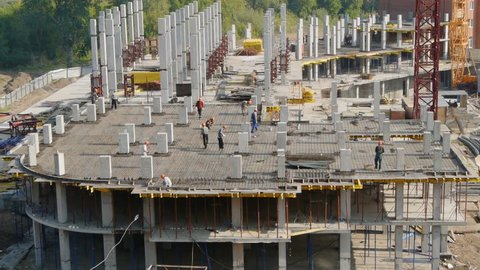 workers on floor of under construction building