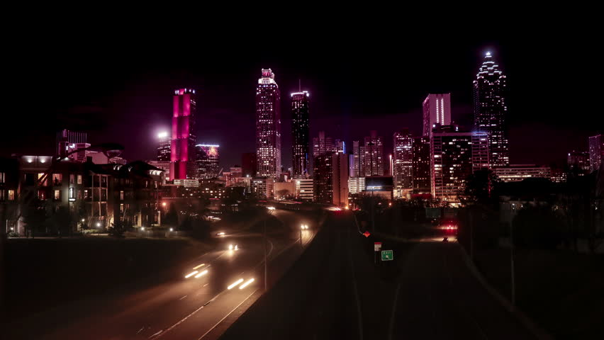 Time lapse of traffic moving in and out of downtown Atlanta, slider shot.