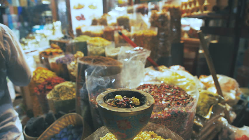 Eastern Market with spices in Emirates. Close-up of spices in different colors on the market in the UAE. Hibiscus, curry, turmeric. Shop owner at spice market arranges display | Shutterstock HD Video #23800267