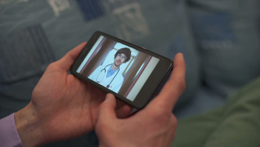 Patient video chatting with doctor | Shutterstock HD Video #23860492