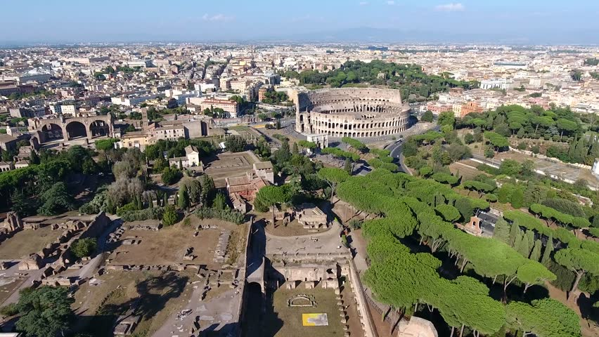 Aerial bird view Italy Rome flying over Domus Severiana moving slowly forwards towards Colosseum extension to imperial palaces Palatine Hill in Roma popular tourist attraction in city center 4k