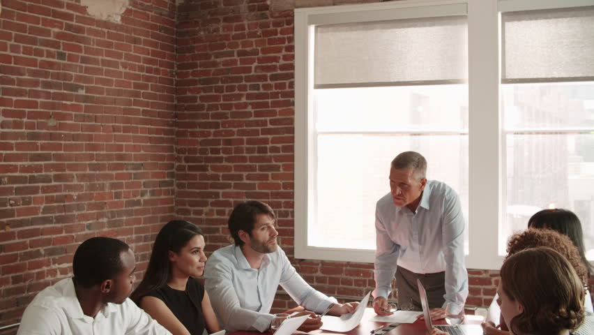 Mature Businessman Standing To Address Boardroom Meeting  | Shutterstock HD Video #23879956