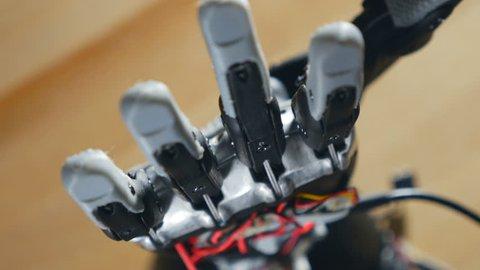 Bionic arm. Innovative robotic hand made on 3D printer. Futuristic technology. Timelapse.