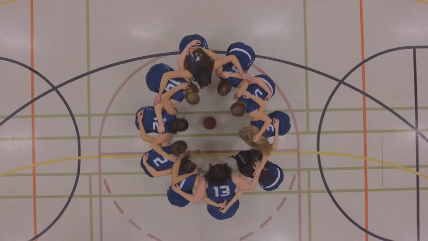 womens basketball team huddle up game plan aerial 4k