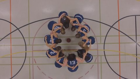 womens basketball team huddle up game plan aerial 4k