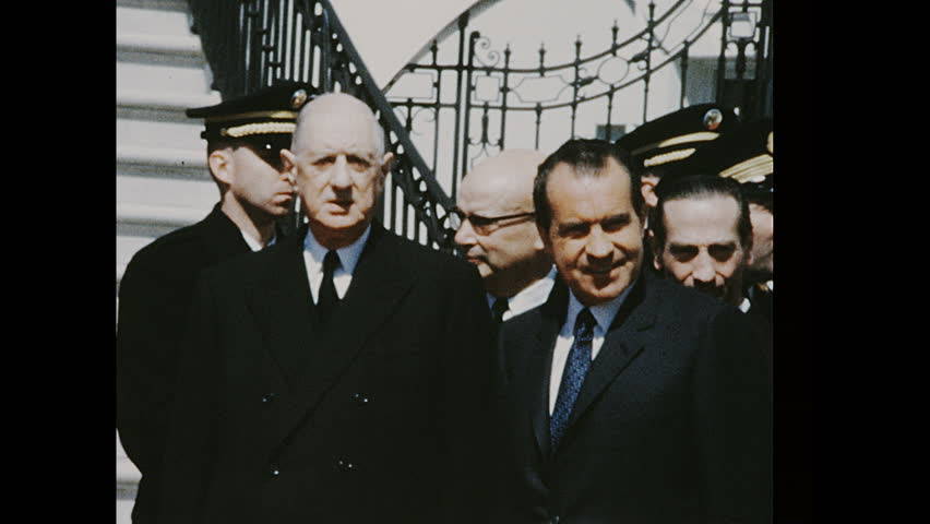 UNITED STATES 1960s: Richard Nixon standing with Charles de Gaulle, pan to car / Nixon and de Gaulle shake hands, de Gaulle enters car.