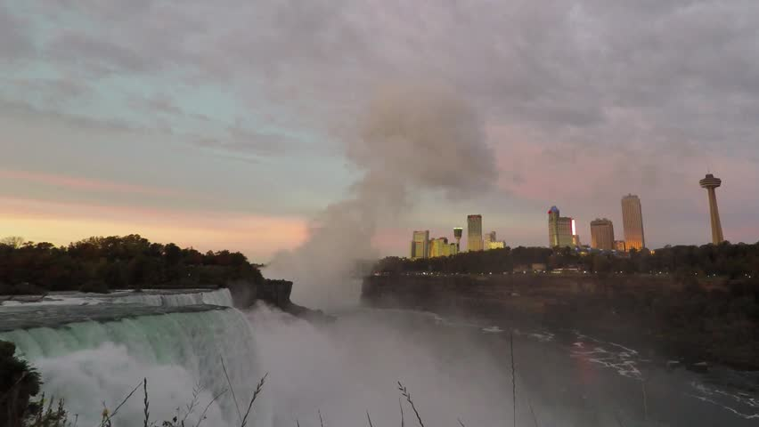 Niagara Falls in Morning with Orange, Pink and Blue Sky and City Skyline   Shutterstock HD Video #23949106