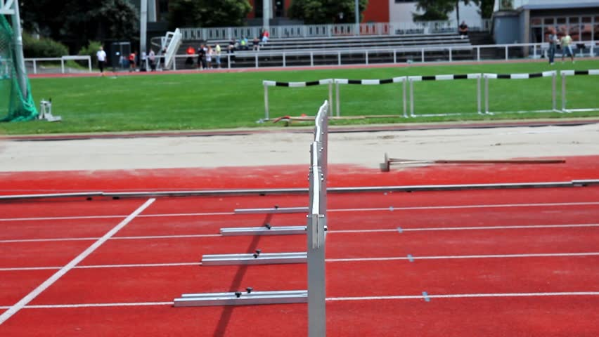 loop and slow motion of female sprinter jumping over the hurdle