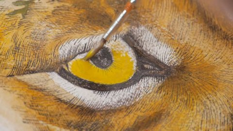 closeup shots of a female artist working on a picture of lynx, whole series from process available,