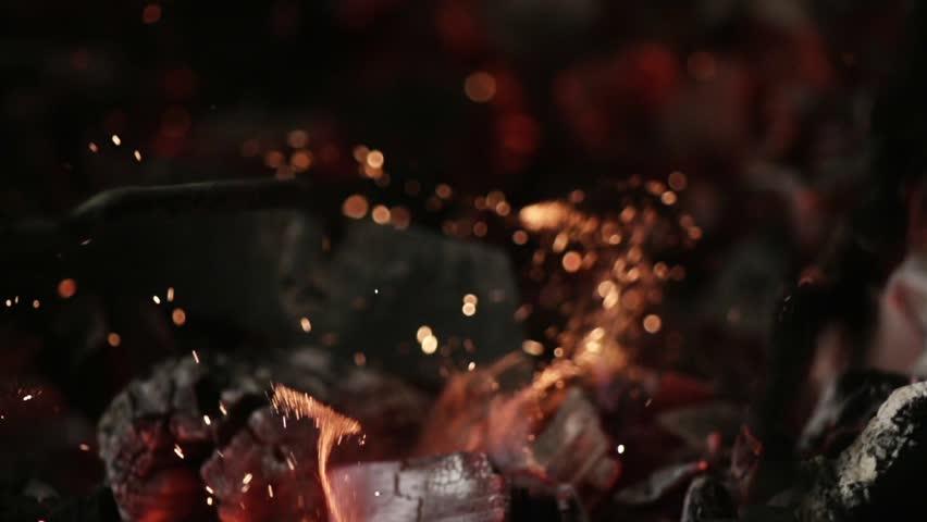 MACRO COALS: iron stick mixes burning coal
