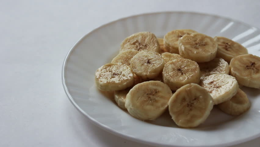 On white plate pieces of banana pours melted chocolate | Shutterstock HD Video #24138646