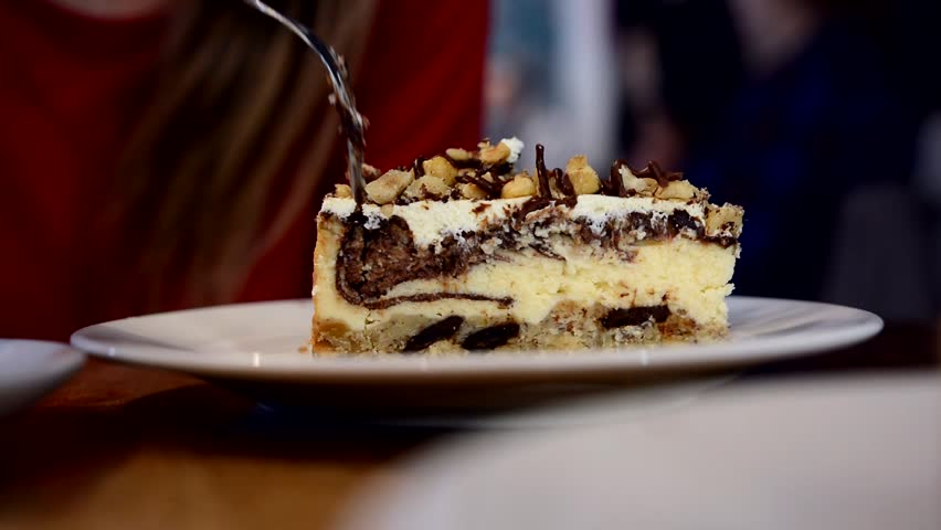 people eat homemade nutella chocolate cheesecake in a cafe