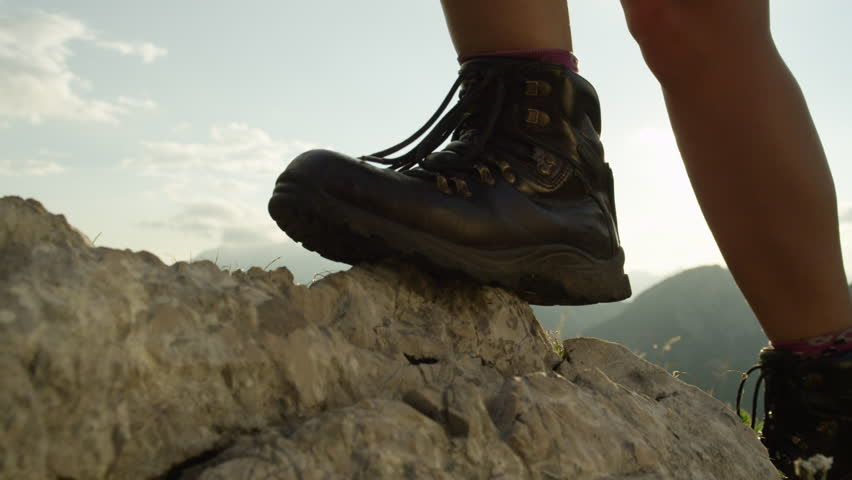 SLOW MOTION, CLOSE UP: Detail of vintage leather mountaineering boots. Unrecognizable adventurous female hiker climbing rocky mountains and walking uphill on amazing sunny summer day in European Alps | Shutterstock HD Video #24178579