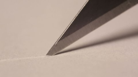 Cutting paper with a craft knife up close