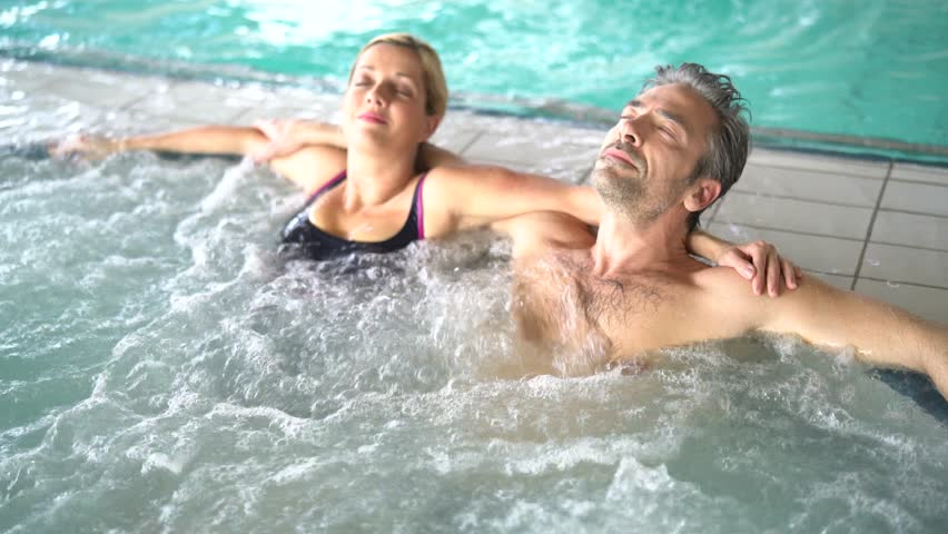 Couple relaxing in thalassotherapy hot tub #24188050