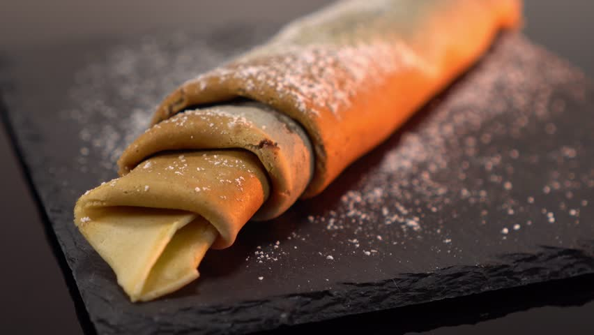 French Crepe filled with chocolate - sweet pancake dessert from France   Shutterstock HD Video #24200896