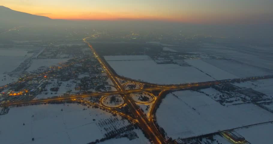 Aerial view of a highway intersection in dusk | Shutterstock HD Video #24203824