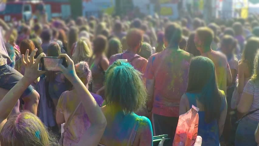 Many people throwing colorful powder in air together, having fun at festival | Shutterstock HD Video #24228937