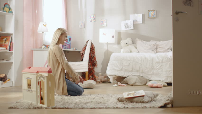 Cute Blonde Girl Runs Towards Her Young Mother and They Hug. Children's Room is Pink, Has Drawings on the Wall and is Full of Toys. Slow Motion. Shot on RED EPIC-W 8K Helium Cinema Camera.