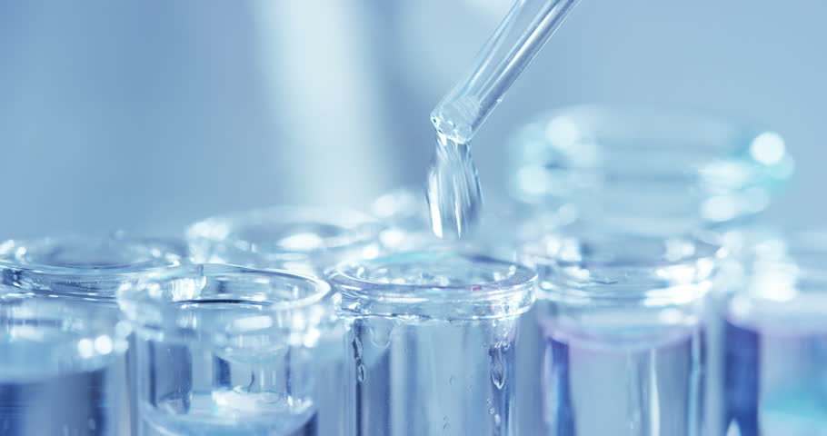 In a laboratory, a scientist with a pipette analyzes a colored liquid to extract the DNA and molecules in the test tubes. Concept: research, biochemistry, nature, pharmaceutical medicine | Shutterstock HD Video #24263966