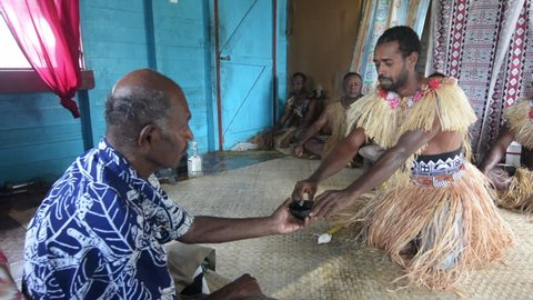 Indigenous Fijians men participate in traditional Kava Ceremony in Fiji