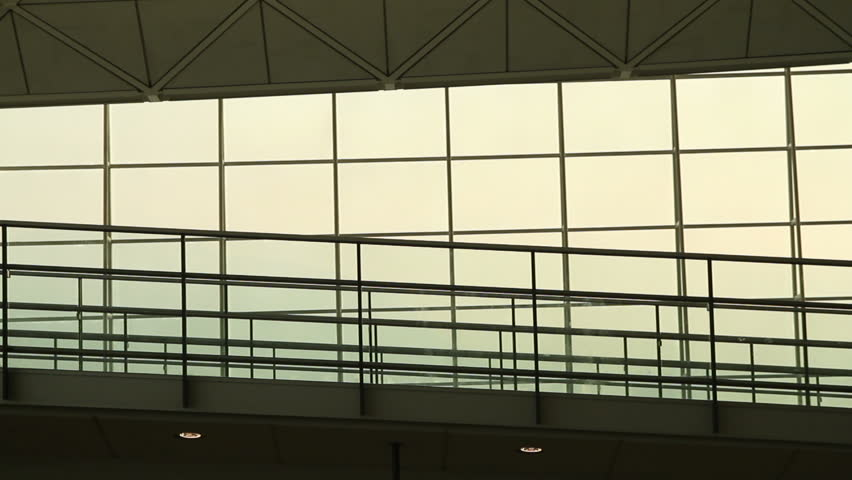 Silhouettes of Family Travellers in Airport - Hong Kong International Airport Terminal. | Shutterstock HD Video #2426906